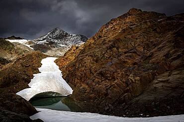 Oetztal mountains with glacier remains and dramatic sky, Soelden, Oetztal, Tyrol, Austria, Europe