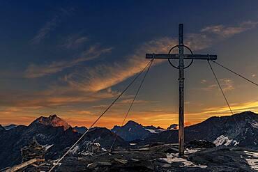 Sunrise over summit of high Nebelkogel with summit cross, Soelden, Oetztal, Tyrol, Austria, Europe