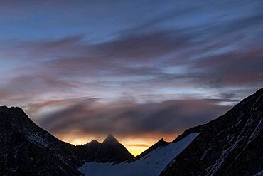 Mountain ridge at sunrise with dramatic clouds, Soelden, Oetztal, Tyrol, Austria, Europe