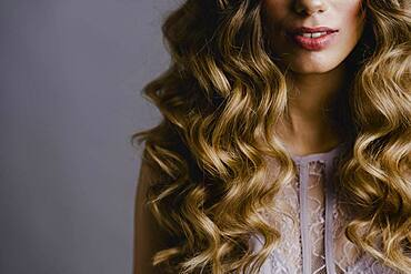 Woman with long curls
