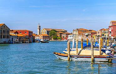 Colorful houses and boats on a canal of Murano, Murano Island, Venice, Veneto, Italy, Europe