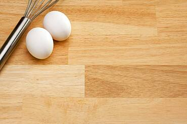 Mixer and eggs on a wooden background