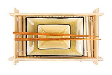 Abstract chopsticks and bowls isolated on a white background