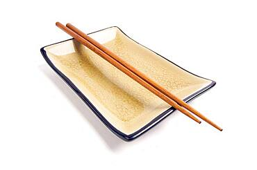 Abstract chopsticks and bowl isolated on a white background