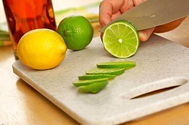 Slicing a lime on a cutting board
