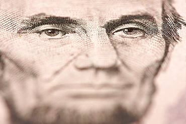 Abstract macro of U.S. five dollar bill's abraham lincoln face with narrow depth of field