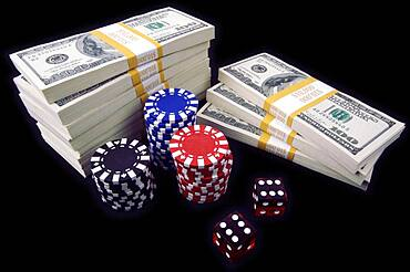 Stack of ten thousand dollar piles of one hundred dollar bills, red dice & poker chips on a black background