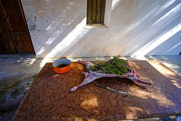 Whole lamb marinating in oil rub and rosemary for asado, in Altea La Vella, Alicante, Spain, Europe