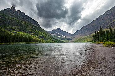 Lake Upper Two Medicine Lake, mountain peaks Lone Walker Mountain and Mount Rockwell in the background, dramatic clouds, Glacier National Park, Montana, USA, North America