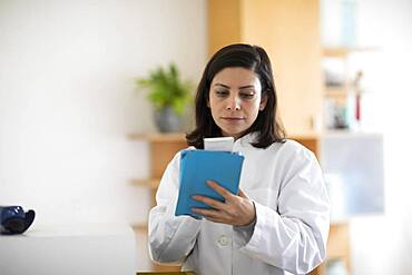 Pharmacist working with medicine in a pharmacy, Germany, Europe