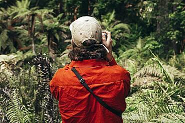 Guy with camera, Redwoods Forest, Whakarewarewa, North Island, New Zealand, Oceania