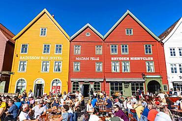 Open air cafes, Bryggen, series of Hnaseatic buildings, Unesco world heritage site, Bergen, Norway, Europe