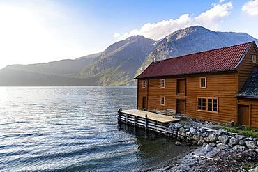 Boatshouse in the harbour of Eidfjord village, Eidfjord, Vestland, Norway, Europe