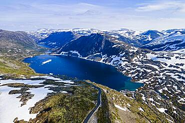 Aerial of a mountain lake in the mountains over Geirangerfjord, Sunmore, Norway, Europe