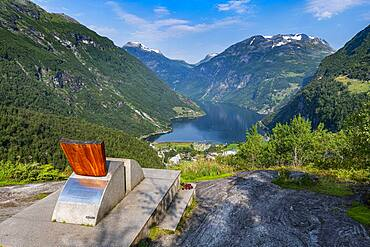 Design chair on a overlook over Geirangerfjord, Sunmore, Norway, Europe