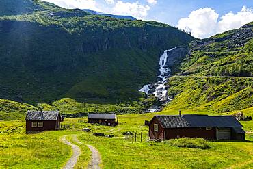 Farmhouses in a green valley near Skei, Norway, Europe