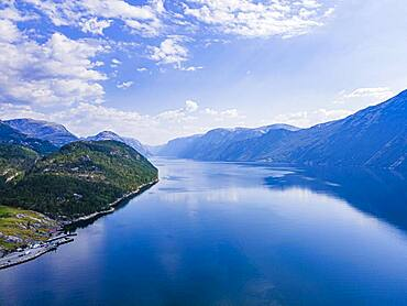 Reflecting mountains in the water, Lystrefjord, Norway, Europe