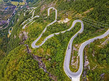 Zigzag road leading down to Lysebodn, at trhe end of Lystrefjord, Norway, Europe