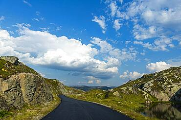 Road leading through the mountain scenery above Lystrefjord, Norway, Europe