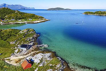 Aerial of a remote little bay and settlement along the road to the Nordkapp, Norway, Europe