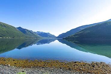 Mountains reflecting in the water, Brensholmen, Senja scenic road, Norway, Europe