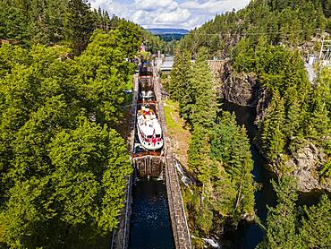 Aerial of a tourist boat in the Vrangfoss lock, Telemark Canal, Norway, Europe