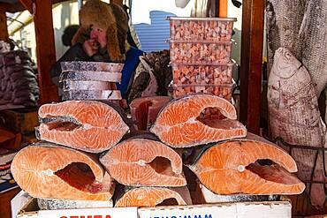 Salmon frozen pieces at the Fish and meat market, Yakutsk, Sakha Republic, Russia, Europe