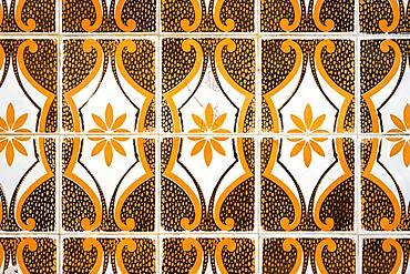 Vintage tiles on the facade of typical Portuguese house in Faro, Algarve