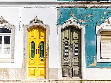 Doors to two different traditional houses, one abandoned and one being renovated in Olhao, Algarve, Portugal, Europe