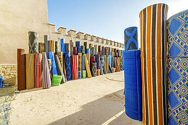 Many rolls of plastic carpet sold on Northafrican open air market in Agadir, Morocco, Africa