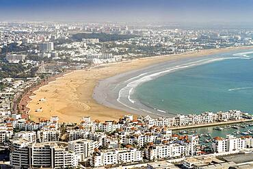 White modern architecture surrounding amazingly wide sandy beach in Agadir, Morocco, North Africa, Africa