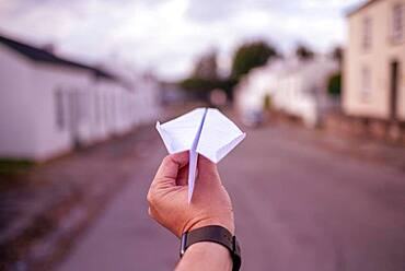 Hand holding paper plane, Grahamstown, South Africa, Africa