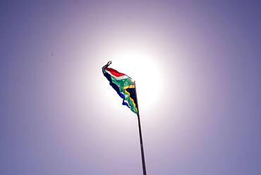 South African flag seen against sun background, Port Elizabeth, South Africa, Africa