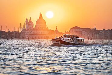 Vaporetto, water bus driving on the lagoon of Venice, evening mood, Basilica Santa Maria della Salute, Venice, Veneto, Italy, Europe