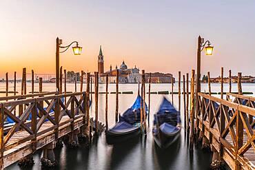 Venetian gondolas, behind church San Giorgio Maggiore, dawn, Venice, Veneto, Italy, Europe