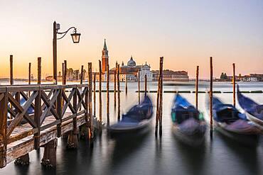 Venetian gondolas, behind church San Giorgio Maggiore, long exposure, dawn, Venice, Veneto, Italy, Europe