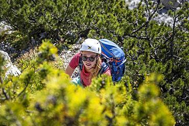 Young female hiker with helmet on the hike to the Hochkalter, Berchtesgadener Alpen, Berchtesgadener Land, Upper Bavaria, Bavaria, Germany, Europe