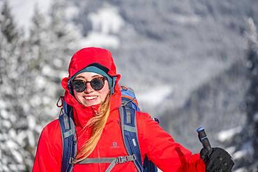 Young woman on ski tour, ski tourers on tour to Teufelstaettkopf, Ammergau Alps, Unterammergau, Bavaria, Germany, Europe