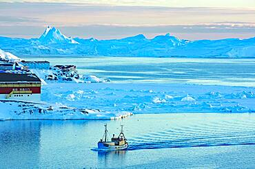 Fishing boat in the blue hour, building, icebergs in the background, Disko Bay, Ilulissat, Greenland, Denmark, North America