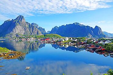 Silent fjord and mountains, Rorbuer, typical wooden houses, Reine, Reinefjord with mountains, Lofoten, Nordland, Norway, Europe