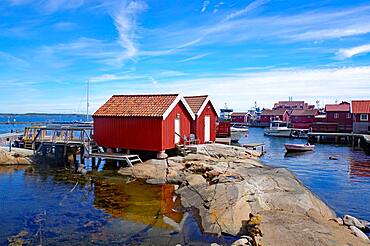 Rocks, boathouses and wooden houses on the archipelago island of Gullholmen, Sweden, Europe