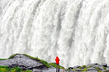 Man in front of the water masses, Dettifoss, Joekulsa a Fjoellum, Iceland, Europe