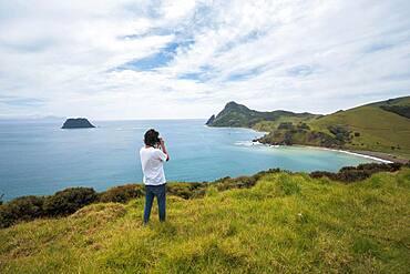 Guy with camera at Fletcher Bay, Coromandel, North Island, New Zealand, Oceania