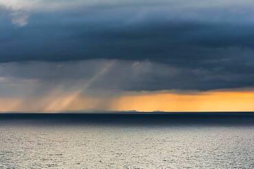 Rain clouds at sunset, Fletcher Bay, Coromandel, North Island, New Zealand, Oceania