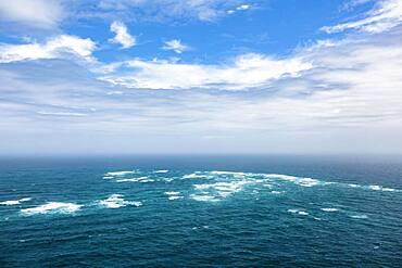 The Tasman Sea (left) meets the Pacific Ocean (right), Cape Reinga, Te Rerenga Wairua, Northland, North Island, New Zealand, Oceania