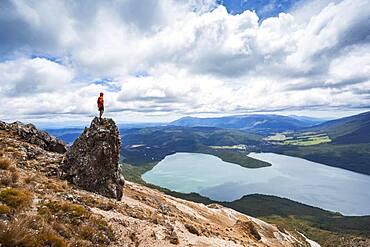 New Zealand, South Island, Region Tasman, Nelson Lakes National Park, Lake Rotoiti, guy standing on rock, Oceania