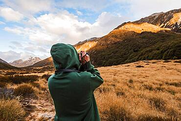 Guy at with camera, Selwyn, Canterbury, South Island, New Zealand, Oceania