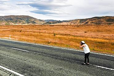 Guy with camera, Omarama, Waitaki District, Canterbury, South Island, New Zealand, Oceania