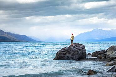 Guy at a beach at Lake Tekapo, Lake Tekapo, Canterbury region, Mackenzie District, South Island, New Zealand, Oceania