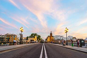 Bridge Puente de Triana, view in direction of the district Triana, sunset, Sevilla, Andalusia, Spain, Europe